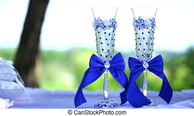 Wedding glasses with blue bows.
