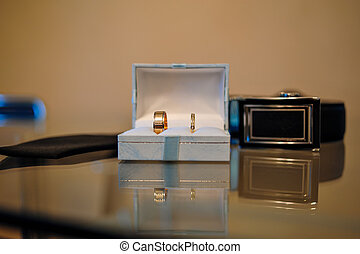 Wedding gold rings in a box on the table