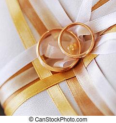 gold rings - wedding gold rings lying on satin pillow