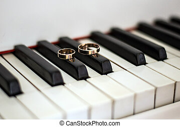 Wedding gold rings on the piano. Wedding accessories