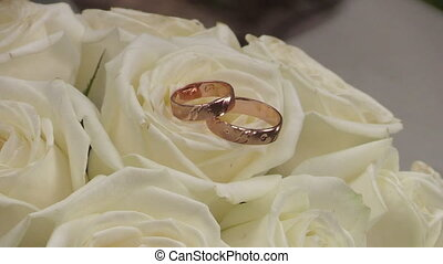 Wedding Gold Rings On The Roses Flo