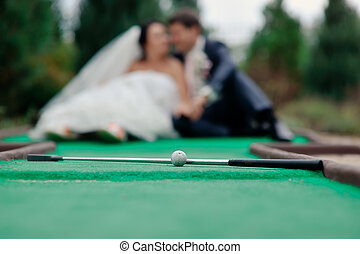 wedding golf - lie on a green field accessories for golf on ...