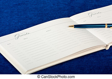 Wedding Guest Book - Opened wedding guest book with a pen on...