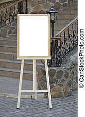 Wedding guest list on wooden easel