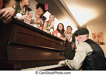 Wedding Guests Having Fun With The Piano