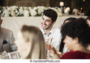 Wedding Guests Socialising At Dinner