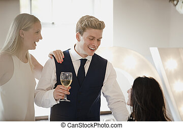 Wedding Guests Socialising At Reception