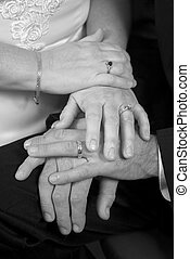 Wedding Hands B&W - A closeup of a newly married couple's...
