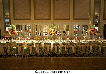 the table of honor at a high end wedding