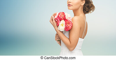 bride or woman with bouquet of flowers