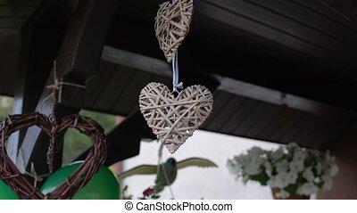 Wedding home decoration. Wicker hearts. Beautiful wedding in Europe.