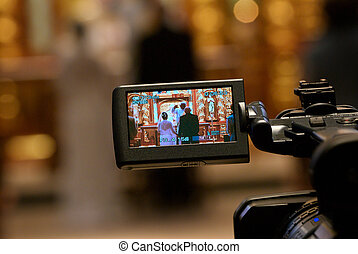 Image of a wedding in progress looking thru videographers viewfinder