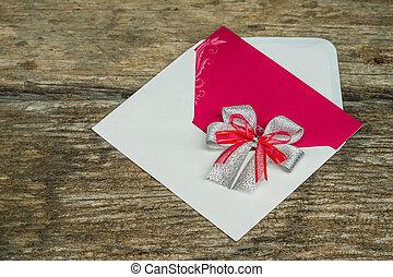 Wedding Invitation card crafting of cardboard lying on a wooden