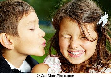 Wedding kiss - Portrait of boy groom kissing his cheerful...