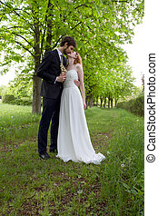 Wedding kiss the bride and groom
