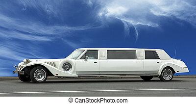 wedding limousine over blue sky