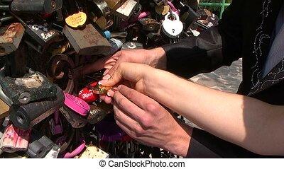 Wedding, lock - The bride and groom secure lock on...