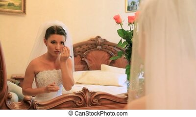 Wedding Make-Up - Bride putting on her make-up