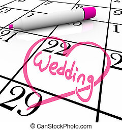 The date of a wedding is circled on a white calendar with a magenta colored marker, surrounded by a drawn heart