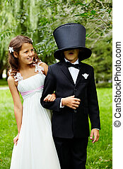 Wedding mood - Portrait of funny children bride and groom on...