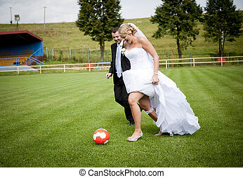 Wedding outdoor portraits - Bride and groom are playing at...