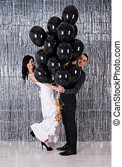 Young couple with black balls