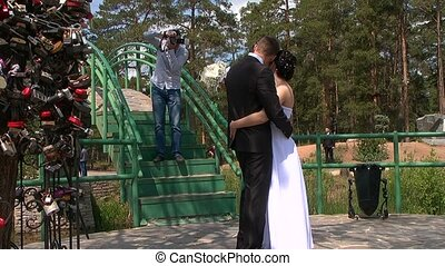 Photographer takes pictures of the bride and groom.