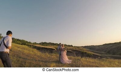wedding photographer takes pictures of the bride and groom