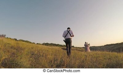 wedding photographer takes pictures of the bride and groom...