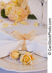 Wedding place setting with roses