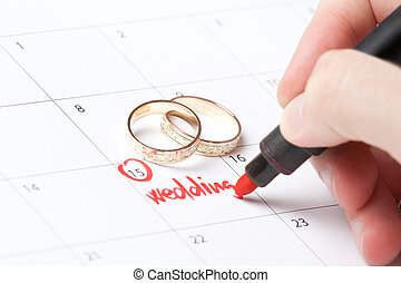 Wedding planning - Wedding rings and hand writing word...