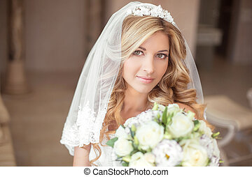 Wedding portrait Beautiful bride girl with long wavy hair and makeup