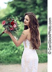 Wedding Portrait Of Beautiful Bride with long wavy hair...