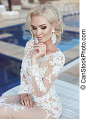 Wedding portrait of  blond bride woman with makeup