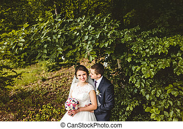 Portrait of bride and groom on the forest
