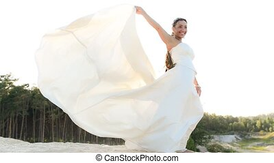 Wedding portrait of bride - Beautiful bride stands on a...
