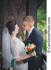 Wedding portrait of happy stylish newlywed bride and groom