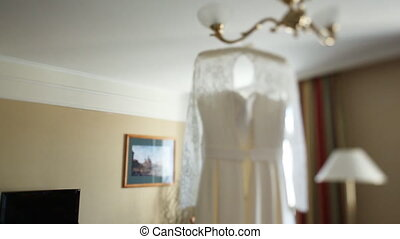 Wedding preparation. Morning of the bride. Wedding dress.