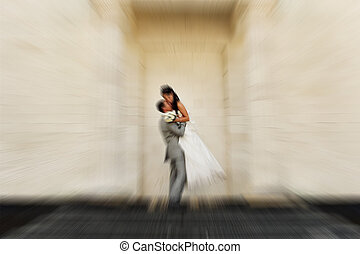 Wedding.  Radial zoom blur effect defocusing filter applied, with vintage instagram look.