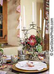 Wedding reception decor details, flowers and table centrepiece