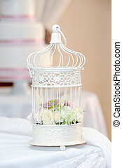 Wedding reception decoration - White cage with roses ...