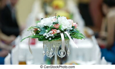 Wedding Reception - Flower arrangement on the wedding diner...