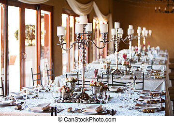 Wedding reception hall with decoarated tables