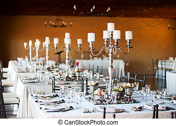 Wedding reception hall with decorated tables
