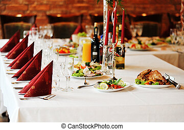 Wedding reception place ready for guests. table with food and drink