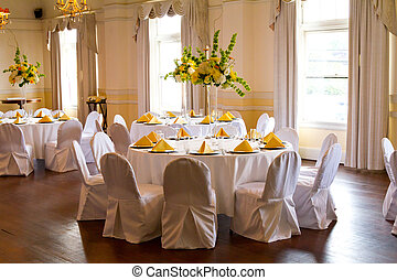 Wedding Reception - Place settings, tables, and chairs are ...