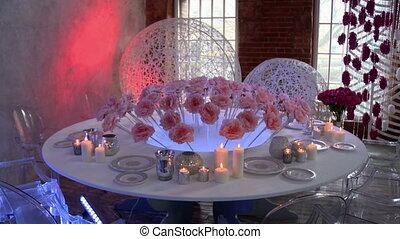 Wedding restaurant interior decorated with roses