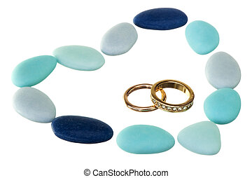 wedding ring  and weddings favors on white background