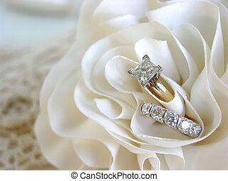 Wedding Ring Background - Diamond wedding rings in the folds...