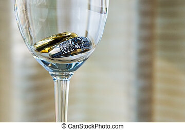Wedding ring in a champagne glass